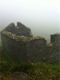 abandoned stone hut in ireland in the mist